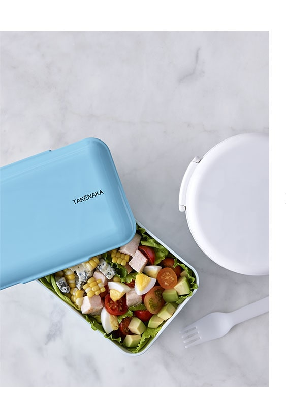 lunch boxes with a salad inside