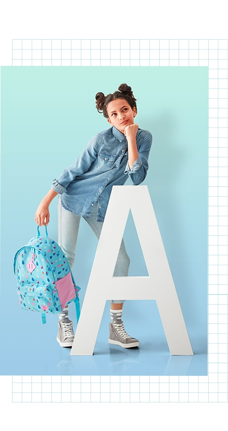 Cool Young girl leaning against the letter A
