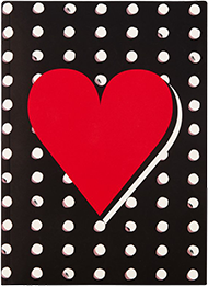 Black journal with white polkadots and a red heart on it.