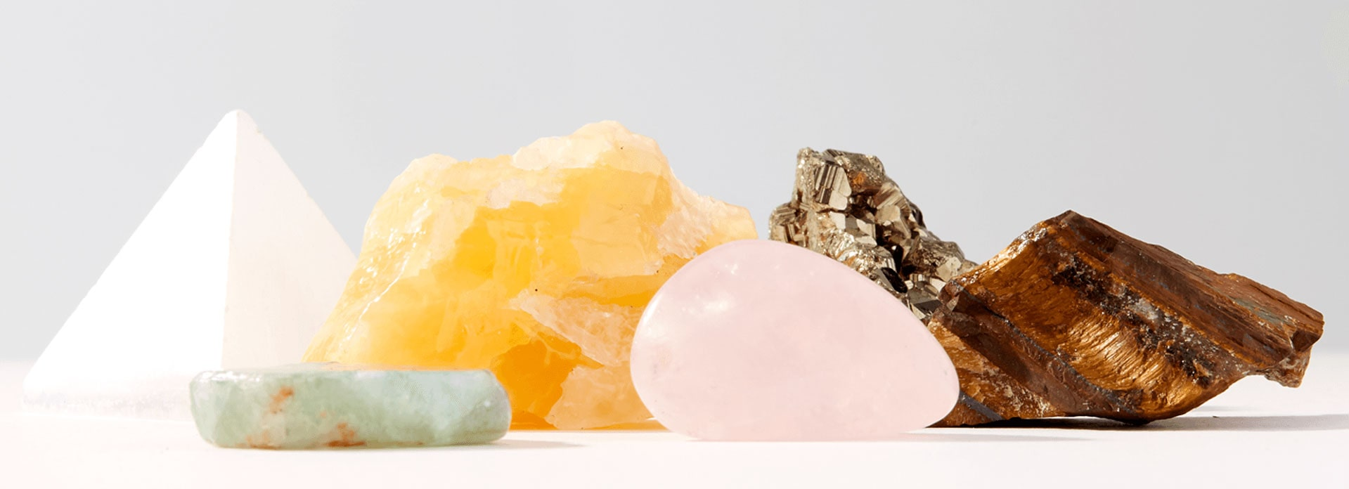 A side view of four crystals on a table.