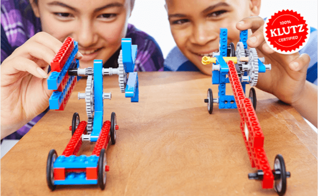 Two kids playing with LEGO toys.